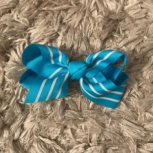 Blue hair bow with white stripes